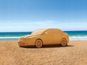 Car on beach sand